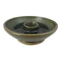 Studio pottery candle holder in bowl form with green melted glass interior