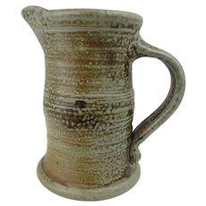 Salt glazed pitcher by American potter Suzy Atkins at Le Dom pottery, France