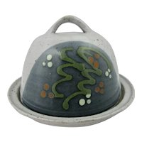 Studio pottery cheese dome by Peter Clough with slip decorated dome.