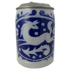 German stoneware lidded stein with cobalt blue leaping horse design