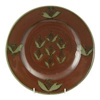 David Frith Studio pottery plate Red glaze with stylised vine leaf motif