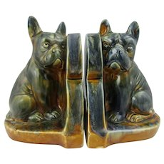 Pair of faience bookends with charmingly modelled French bulldog figures
