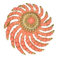 "Signed Crown Trifari ""Whirlwind"" sunburst brooch in Coral"