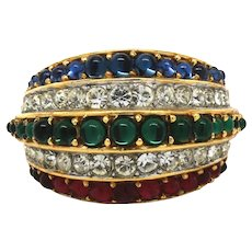 Signed Crown Trifari gold tone ring with ruby, sapphire, and emerald glass stones
