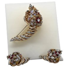 Signed Reja Cornucopia brooch and earrings set with glass opals and imitation rubies