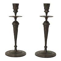 A Classic Pair of Bronze Candlesticks