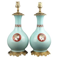 Pair of  porcelain Lamps with gilt brass mounted Etruscan revival medallion on turquoise ground