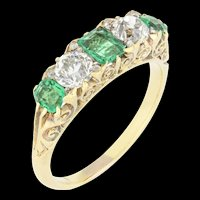 A Late Victorian Emerald And Diamond Carved Half Hoop Ring
