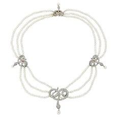 A Natural Pearl Necklace With Diamond Set Snakes