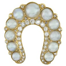 A Victorian Natural Pearl And Diamond Horseshoe Brooch