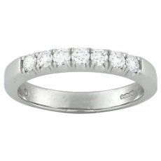 A Platinum Seven Stone Diamond Half Eternity Ring