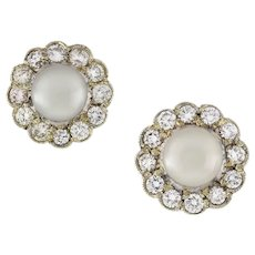 A Pair Of Edwardian Pearl And Diamond Cluster Earrings