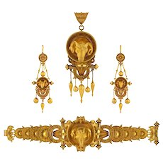 A Gold Etruscan Revival Suite With Ram's Head Decorations