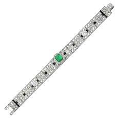 A fine Art Deco emerald, onyx and diamond bracelet