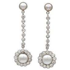 A Pair Of Edwardian Natural Pearl And Diamond Drop Earrings