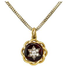 A Victorian garnet and diamond pendant