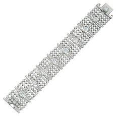 A mid-20th century wide diamond-set bracelet