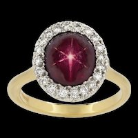 A Burmese Star Ruby And Diamond Cluster Ring