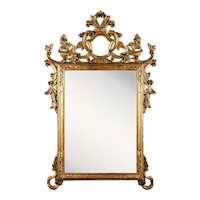 Antique Imperio Mirror. Late 19th century. (122x78x18cm) finely carved, gilded frme with floral motifs and scrolls. Absolutely gorgeous!