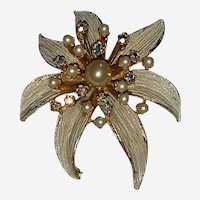 BSK signed Vintage Brooch Simulated Pearls and Aurora Borealis Rhinestones Gold Color Frame Long Textured Petals