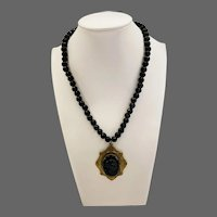 Art Deco 1920s Faceted Jet Beaded Necklace with a Large Starburst French Jet Cameo