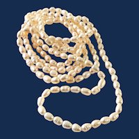 Long Strand White Fresh Water Pearl Necklace