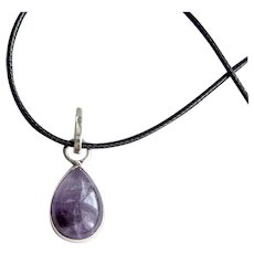 Handmade silver pendant with natural amethyst in the form of a drop