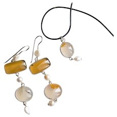 Unique set of earrings with a pendant orange carnelian