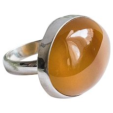 Silver ring with natural transparent orange carnelian