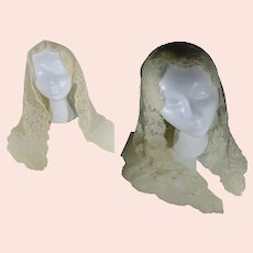 Two Triangle Mantilla About the Same Size One Beige the Other Soft Yellow