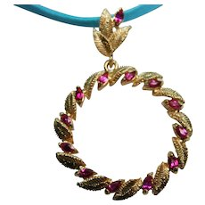 Classic Dangling Ruby and Golden Leaf Circle Pendant with Fancy Bail