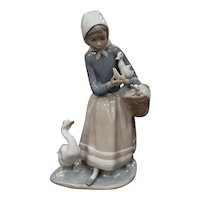 SIGNED and dated Lladro 4568. Shepherdess with ducks. Perfect condition. Glossy version. Porcelain and hand painted. Tall at 9 inches