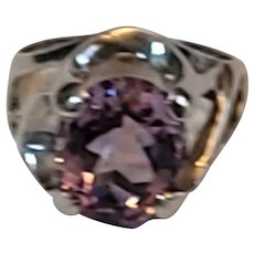 Sterling and amethyst ring. Bright sterling with remarkable oval amethyst ring. Absolutely beautiful. Size 5.75