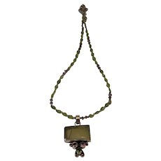 "Peridot And Amethyst Sterling Necklace. Pendant is 1.75"" 18"" beaded. Beautiful"