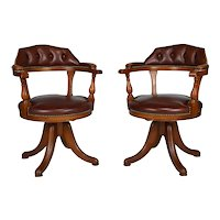 Pair of swivel office chairs, wood and leather, Chesterfield style