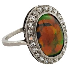 A Certificated Black Opal, Diamond and Platinum Ring Circa 1920