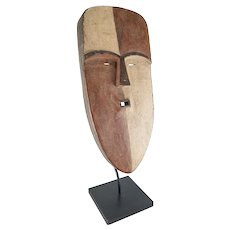 Decorative African Carved Wooden Mask with Red and White Pigment
