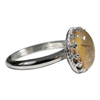 925 silver Ring with Rutilated quartz, cabochon cut 10 x 12 mm