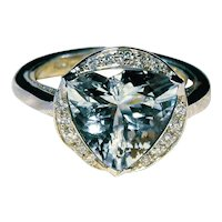 18 Kt white gold ring with triangular aquamarine Ct 3.8 and diamond  0.23 Ct.