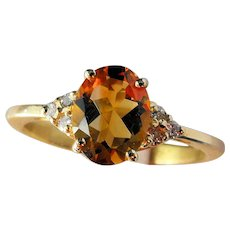 Yellow 18 kT gold ring with citrine quartz and diamonds