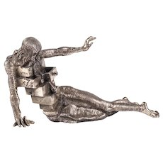 "A solid sterling silver sculpture ""Le cabinet Anthropomorphique"" by Salvador Dali"