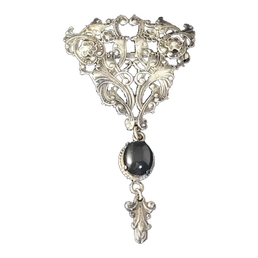 Sterling Silver Vintage hand crafted brooch pin pierced cut work, embossed and applied work. black stone.