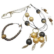Cappadocia... jewelry set made of so called shell pearls (beads manufactured from natural oyster shells) in black and gold color and natural freshwater pearls