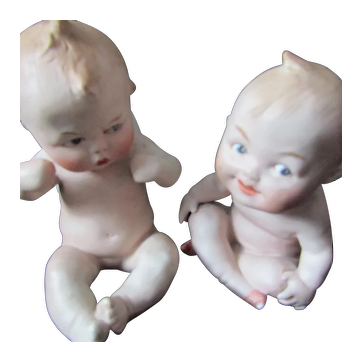 Vintage pair of Bisque Easter Egg character baby posy holders