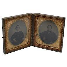 Twin daguerreotypes in a double gutta percha frame