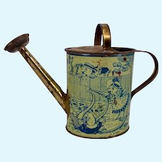 Wonderful vintage lithographed tin doll watering can