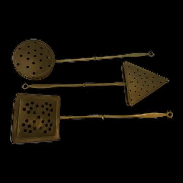 Vintage brass/copper chestnut roasters.