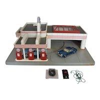 Vintage HO Esso Gas Station with car, powered by track & Corgi Oldsmobile Toronado