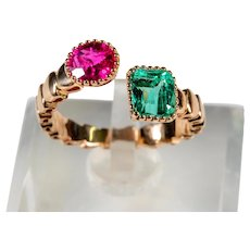 Contrariè  ring in 18 kt rose gold with ruby and emerald