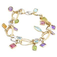 Fancy bracelet in 18kt yellow and white gold with precious stone pendants
